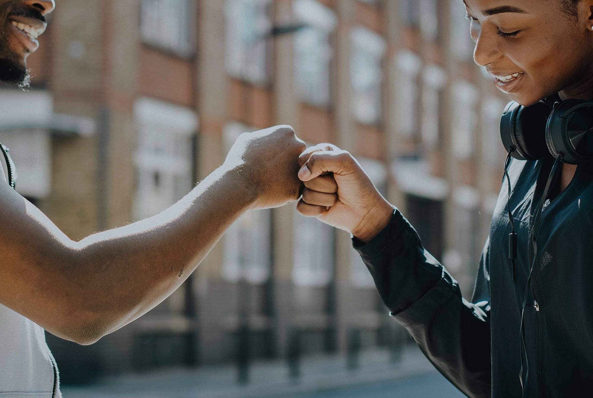 A girl and a boy are making a gesture of friendship