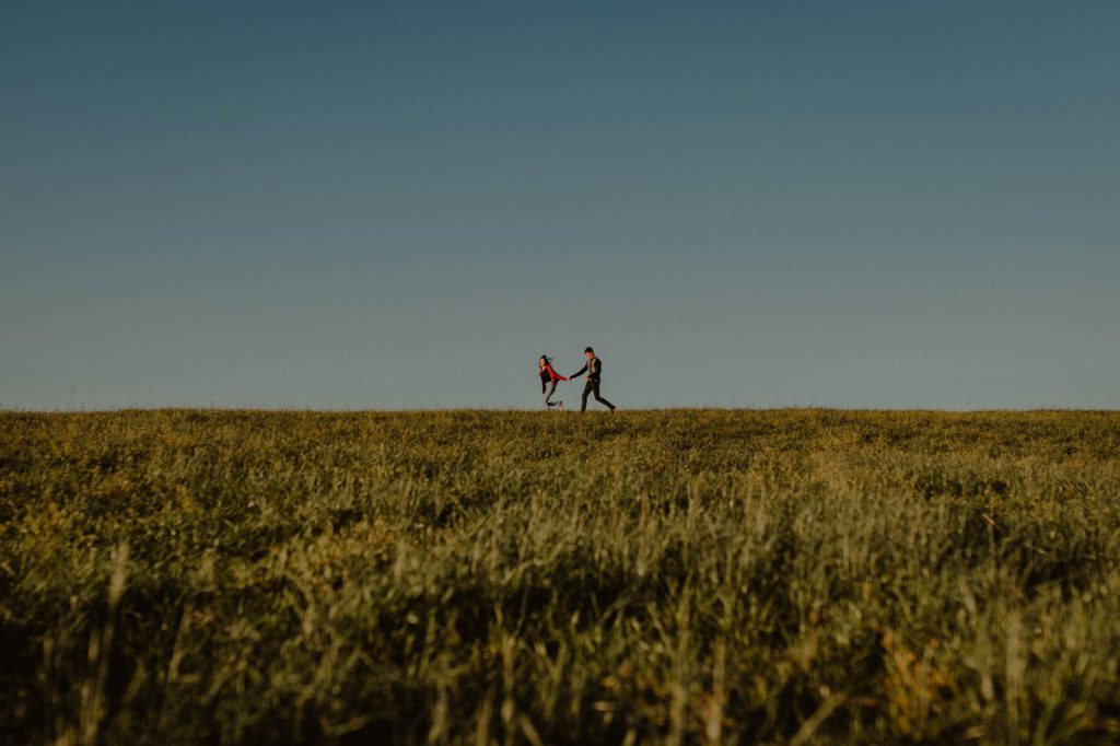 Couple Running Happily In The Field